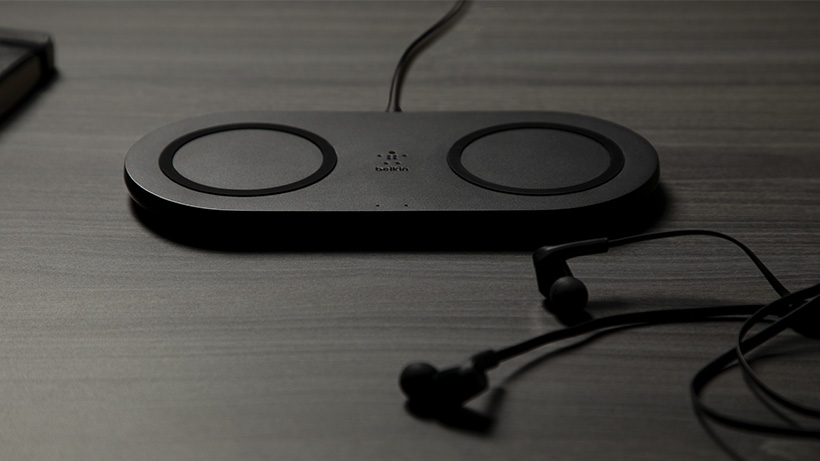BOOST↑CHARGE Dual Wireless Charging Pad on a desk