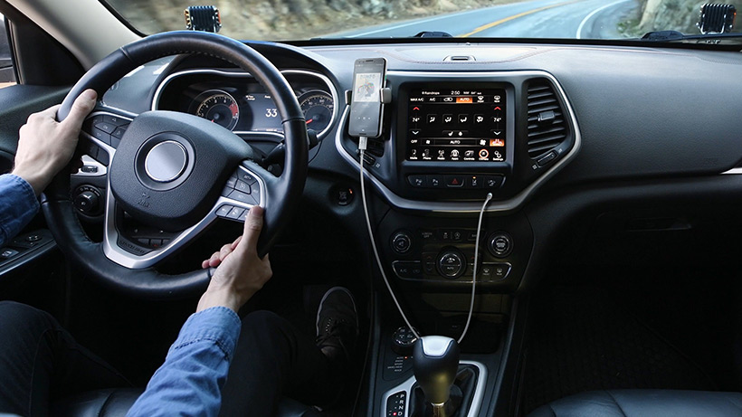RockStar™ 3.5mm Audio Cable with USB-C™ Connector plugged into a car dashboard