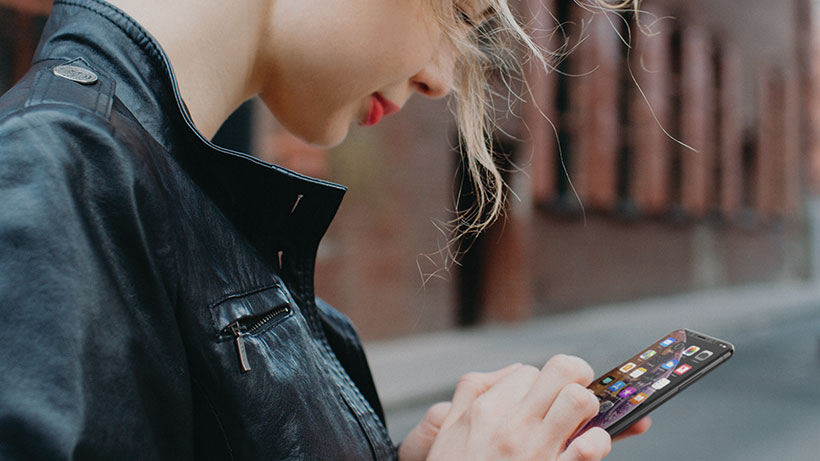Woman using the iPhone touchscreen